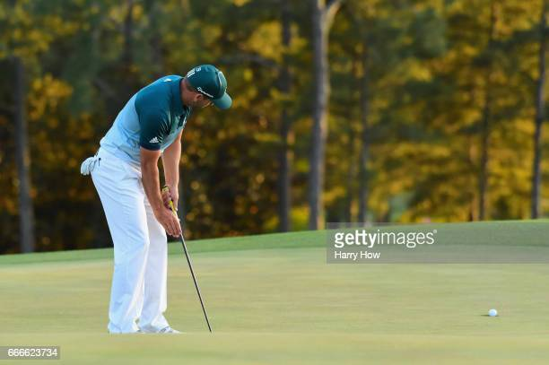 Sergio Garcia of Spain sinks his putt to defeat Justin Rose of England on the first playoff hole during the final round of the 2017 Masters...