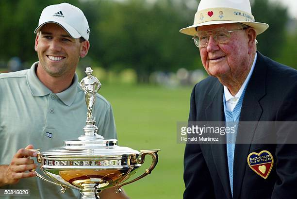 Sergio Garcia of Spain smiles with Byron Nelson after winning the EDS Byron Nelson Championship on May 16 2004 at the TPC Las Colinas in Irving Texas
