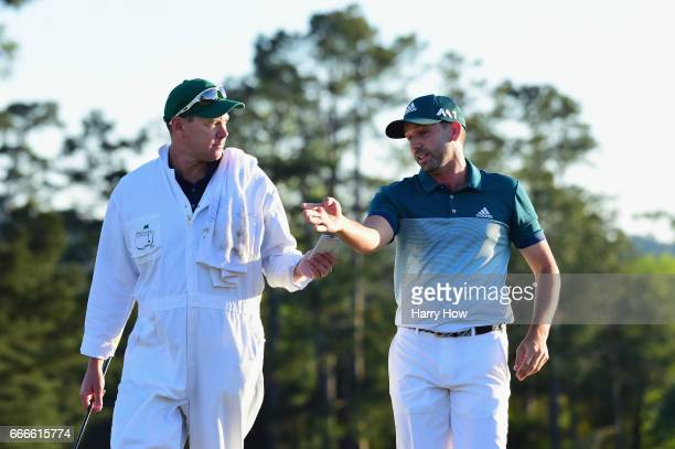 Sergio Garcia of Spain talks with caddie Glen Murray after missing a putt on the 18th hole to start a playoff during the final round of the 2017...