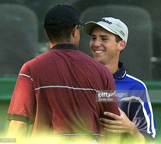 Sergio Garcia of Spain talks with Tiger Woods of the US after Woods won the 81st PGA Championship 15 August 1999 held on the No 3 course at Medinah...
