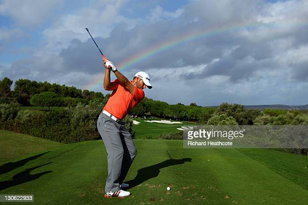Sergio Garcia of Spain tee's off at the 15th as a rainbow appears in the sky during the first round of the Andalucia Masters at Valderrama on October...