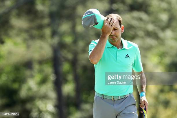 Sergio Garcia of Spain tips his cap on the 18th green during the first round of the 2018 Masters Tournament at Augusta National Golf Club on April 5,...