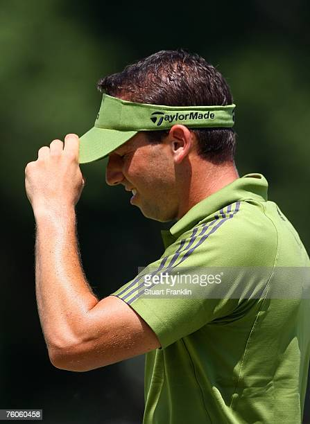 Sergio Garcia of Spain walks off the 18th green during the third round of the 89th PGA Championship at the Southern Hills Country Club on August 11...