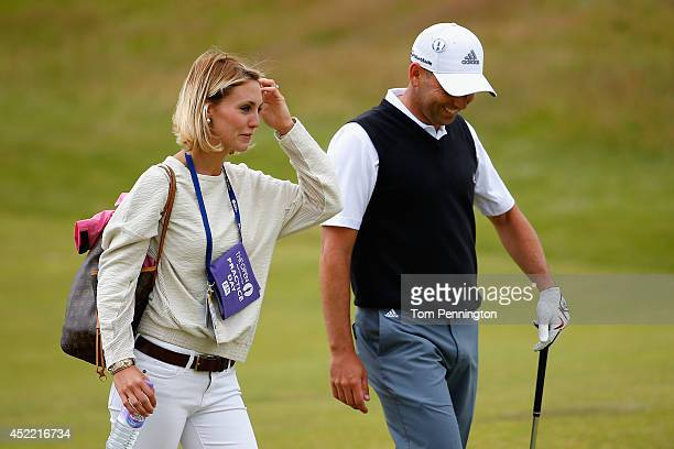 Sergio Garcia of Spain walks with girlfriend Katharina Boehm during a practice round prior to the start of The 143rd Open Championship at Royal...