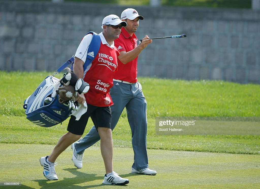 Sergio Garcia of Spain walks with his caddie Glen Murray on the fourth hole during the second round of the WGC - HSBC Champions at the Sheshan International Golf Club on November 7, 2014 in Shanghai, China.