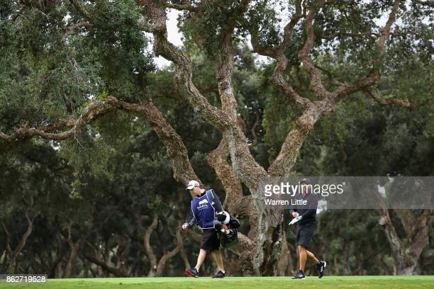 Sergio Garcia of Spain walks with his caddie Glenn Murray during the pro am ahead of the Andalucia Valderrama Masters at Real Club Valderrama on...