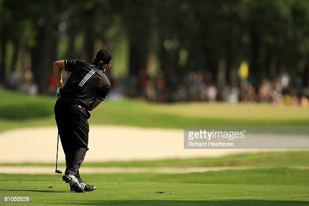 Sergio Garcia of Spain watches his approach shot on the 11th hole during the final round of THE PLAYERS Championship on THE PLAYERS Stadium Course at...