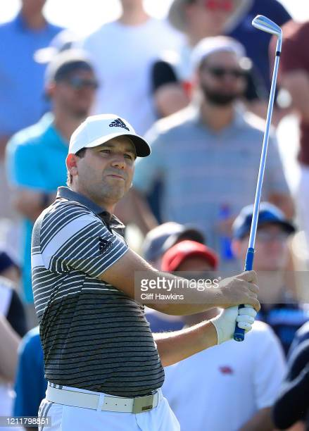 Sergio Garcia of Spain watches his tee shot during a practice round prior to The PLAYERS Championship on The Stadium Course at TPC Sawgrass on March...