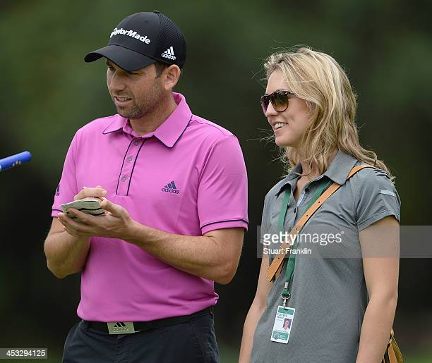 Sergio Garcia of Spain with his friend Katharina Boehm during the pro - am prior to the start of the Nedban Golf Challenge at Gary Player CC on...