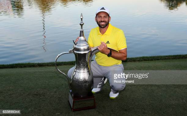 Sergio Garcia of Spain with the winners trophy after the final round of the Omega Dubai Desert Classic at Emirates Golf Club on February 5 2017 in...