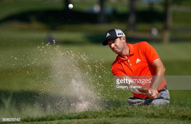 Sergio Garcia plays a shot out of a bunker on the fifth hole during the first round of the World Golf Championships Bridgestone Invitational at...
