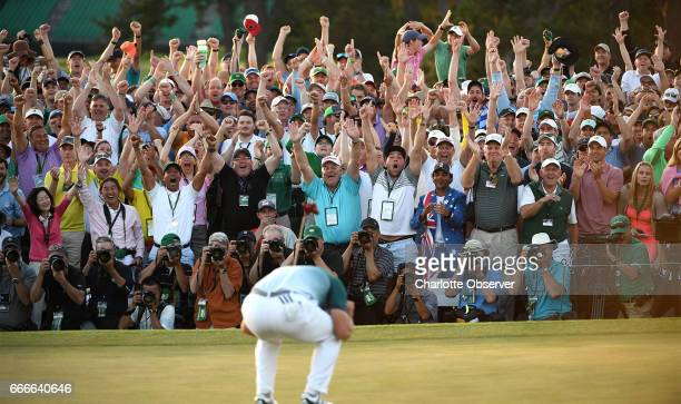 Sergio Garcia reacts with the fans after sinking the winning putt to defeat golfer Justin Rose in a one-hole playoff on the 18th green on Sunday,...