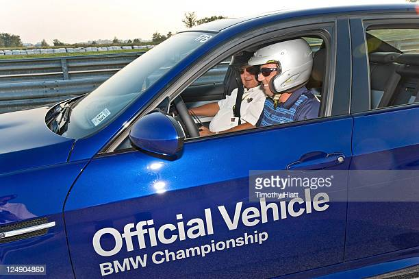 Sergio Garcia take a BMW for a test drive to raise money to benefit the Evans Scholars Foundation at Autobahn Racetrack on September 13, 2011 in...