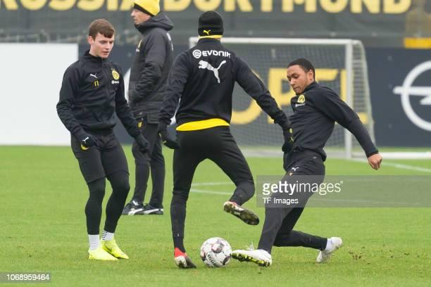 Sergio Gomez of Borussia Dortmund Achraf Hakimi of Borussia Dortmund and Abdou Diallo of Borussia Dortmund battle for the ball during a training...