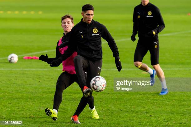 Sergio Gomez of Borussia Dortmund and Achraf Hakimi of Borussia Dortmund battle for the ball during a training session at BVB training center on...