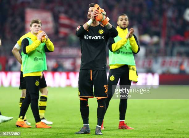 Sergio Gomez of Dortmund Goalkeeper Roman Buerki of Dortmund and Jeremy Toljan of Dortmund look dejected after the Bundesliga match between FC Bayern...
