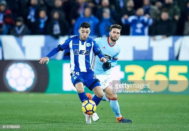 Sergio Gomez of RC Celta de Vigo duels for the ball with Munir El Haddadi of Deportivo Alaves during the La Liga match between Deportivo Alaves and...