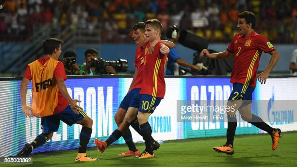 Sergio Gomez of Spain is mobbed by team mates after scoring during the FIFA U17 World Cup India 2017 Quarter Final match between Spain and Iran at...
