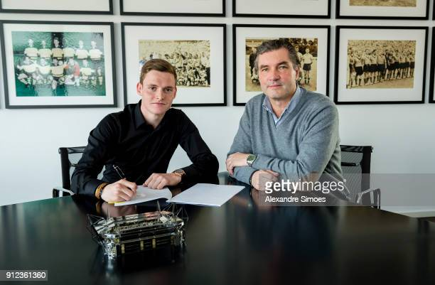 Sergio Gomez signs a new contract with Borussia Dortmund at Borussia Dortmund's office with Michael Zorc on January 30 2018 in Dortmund Germany
