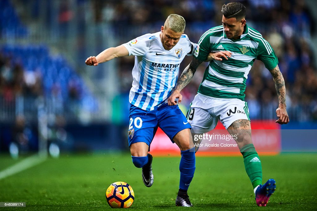 Sergio Gontan 'Keko' of Malaga CF (L) competes for the ball with Arnaldo Antonio Sanabria of Real Betis Balompie (R) during La Liga match between Malaga CF and Real Betis Balompie at La Rosaleda Stadium February 28, 2017 in Malaga, Spain.
