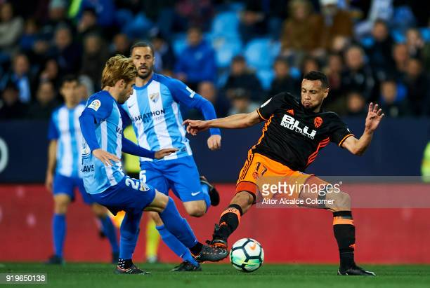 Sergio Gontan 'Keko' of Malaga duels for the ball with Francis Coquelin of of Valencia CF during the La Liga match between Malaga and Valencia at...