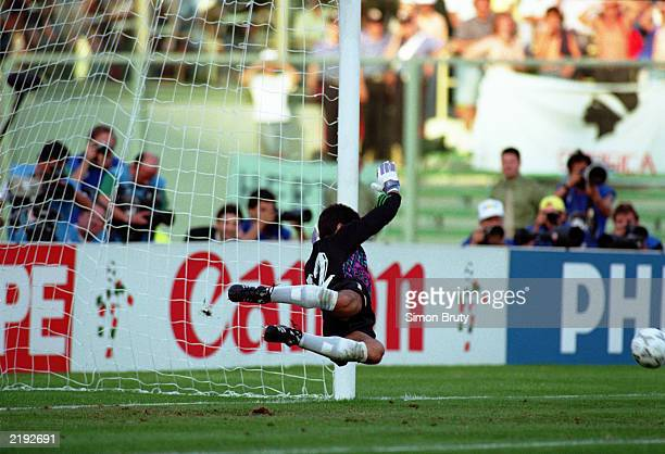 Sergio Goycochea of Argentina makes the vital save to win the match for his country in the penalty shootout during the FIFA World Cup Finals 1990...