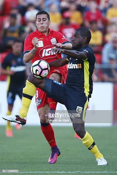 Sergio Guardiola of Adelaide United competes for the ball with Jacques Faty of the Central Coast Mariners during the round five ALeague match between...