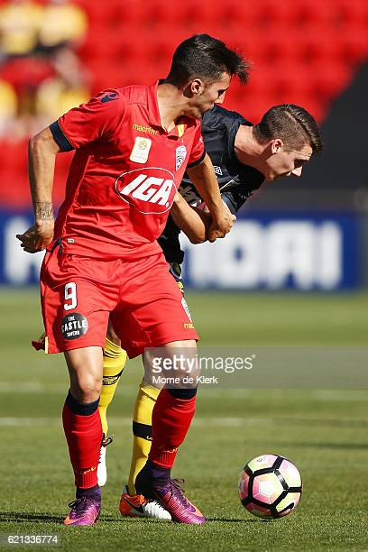 Sergio Guardiola of Adelaide United competes for the ball with Jake McGing of the Central Coast Mariners during the round five ALeague match between...