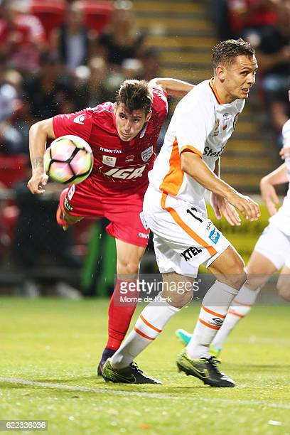 Sergio Guardiola of Adelaide United heads the ball to score a goal during the round six ALeague match between Adelaide United and Brisbane Roar at...