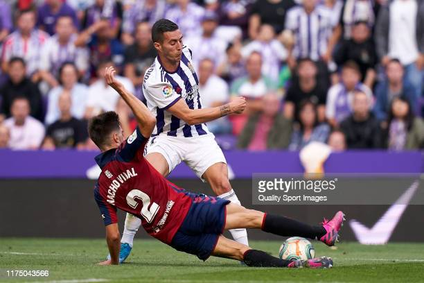 Sergio Guardiola of Valladoid CF battle for the ball with Nacho Vidal of CA Osasuna during the Liga match between Real Valladolid CF and CA Osasuna...