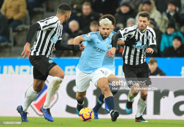 Sergio guero of Manchester City is challenged by Fabian Schar of Newcastle United during the Premier League match between Newcastle United and...
