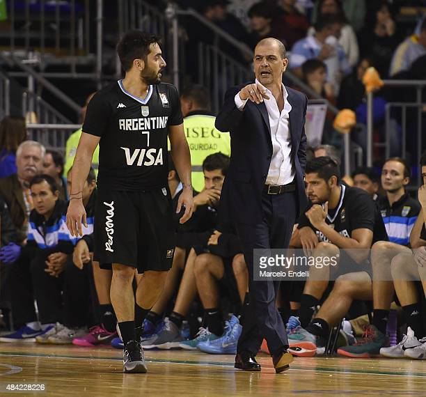 Sergio Hernandez coach of Argentina gives instructions to his player Facundo Campazzo during a match between Argentina and Brazil as part of Four...