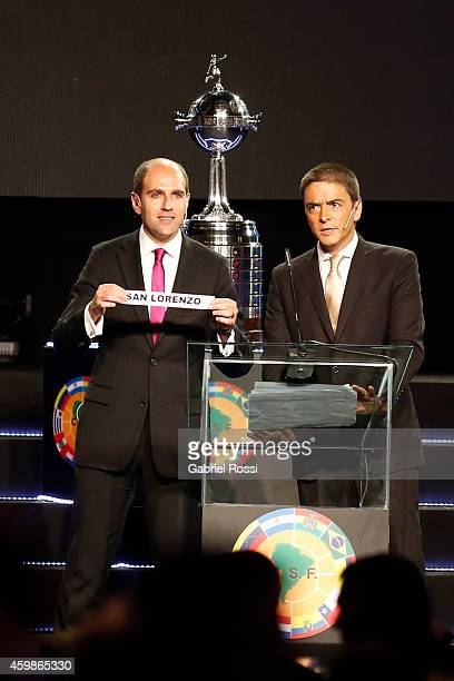 Sergio Jadue President of the Chilean Football Association holds the name of San Lorenzo current champion during the Official Draw of the 56th Copa...