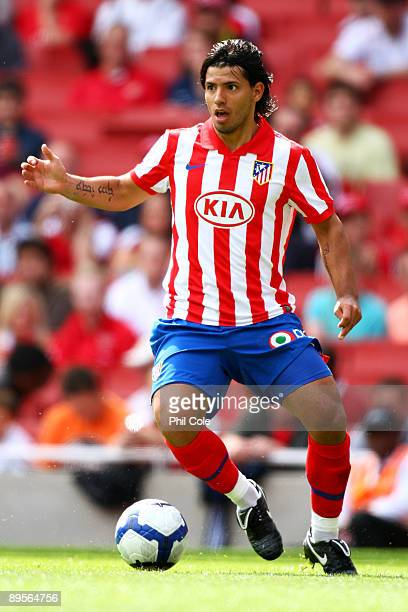 Sergio Kun Aguero of Athletico controls the ball during the Emirates Cup match between Athletico Madrid and Paris SaintGermain at the Emirates...