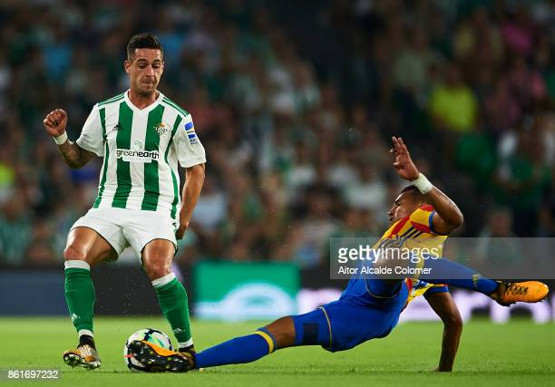 Sergio Leon of Real Betis Balompie being fouled by Jeison Murillo of Valencia CF during the La Liga match between Real Betis and Valencia at Estadio...