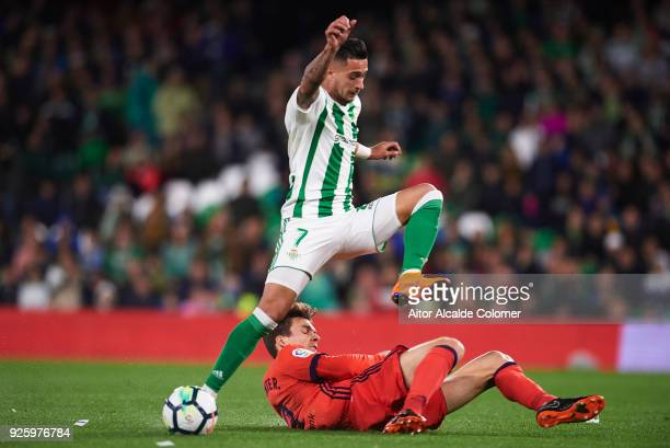 Sergio Leon of Real Betis Balompie competes for the ball with Diego Llorente of Real Sociedad during the La Liga match between Real Betis and Real...