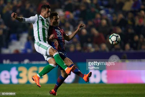 Sergio Leon of Real Betis Balompie competes for the ball with Postigo of Levante UD during the La Liga match between Levante UD and Real Betis at...
