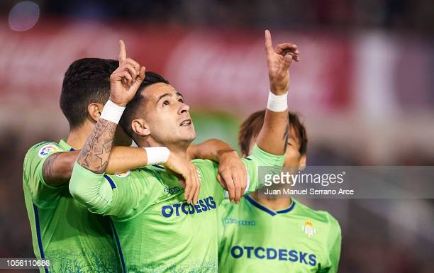 Sergio Leon of Real Betis celebrates with his teammate Takashi Inui and Marc Bartra after scoring the opening goal during the Spanish Copa del Rey...