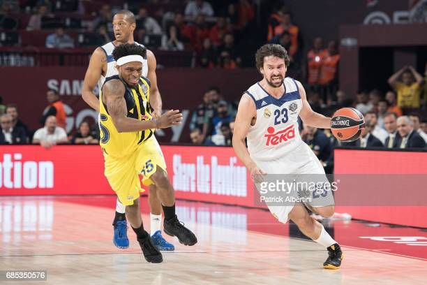 Sergio Llull #23 of Real Madrid competes with Bobby Dixon #35 of Fenerbahce Istanbul during the Turkish Airlines EuroLeague Final Four Semifinal A...