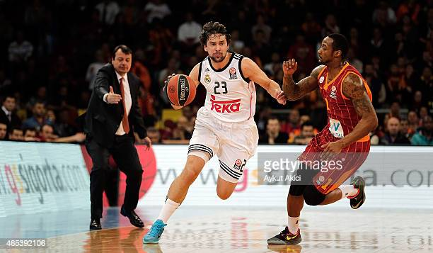 Sergio Llull #23 of Real Madrid competes with Justin Carter #1 of Galatasaray Liv Hospital Istanbul during the Turkish Airlines Euroleague Basketball...