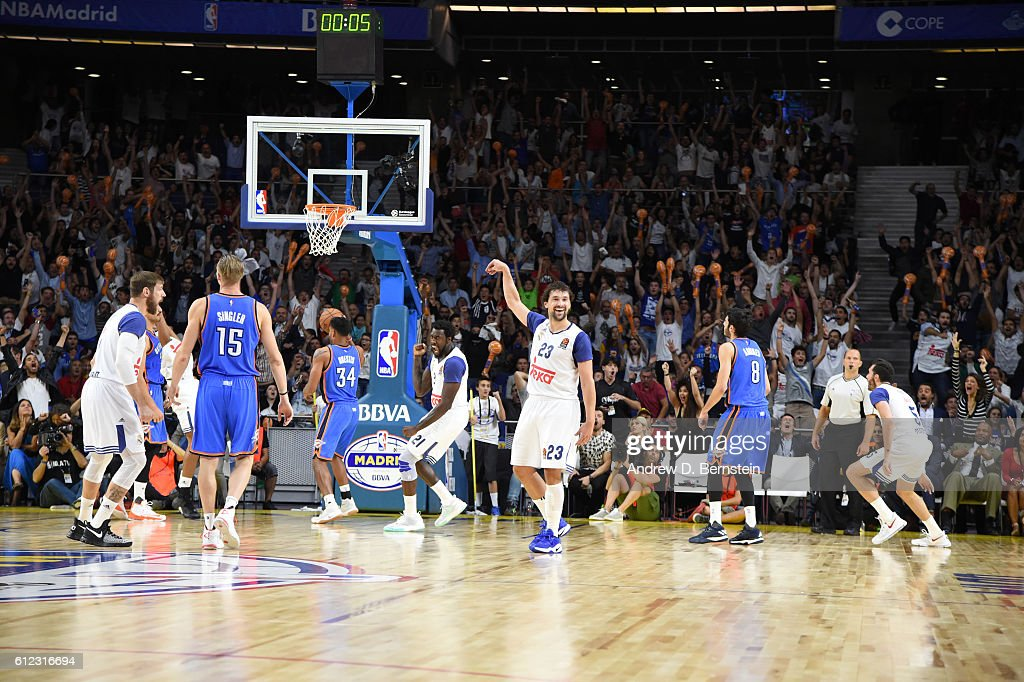 Sergio Llull #23 of Real Madrid hits a game tying three pointer against the Oklahoma City Thunder to go to overtime as part of the 2016 Global Games on October 3, 2016 at the Barclaycard Center in Madrid, Spain.