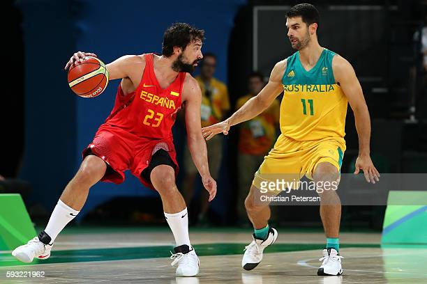 Sergio Llull of Spain drives for the basket against Kevin Lisch of Australia during the Men's Basketball Bronze medal game between Australia and...
