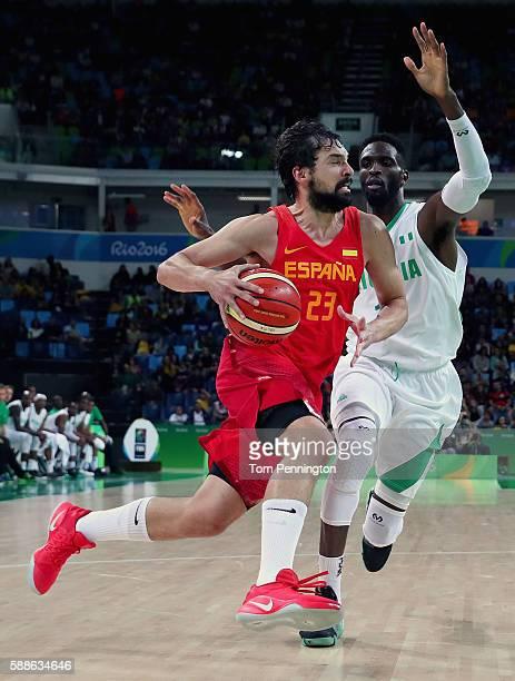 Sergio Llull of Spain drives to the basket against Ekene Ibekwe of Nigeria during the Men's Basketball - Preliminary Round Group B Nigeria vs Spain...