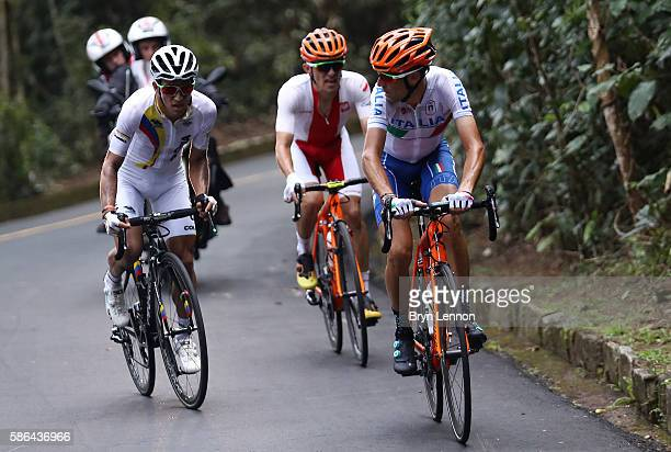 Sergio Luis Henao Montoya of Colombia and Vincenzo Nibali of Italy compete before their crash during the Men's Road Race on Day 1 of the Rio 2016...
