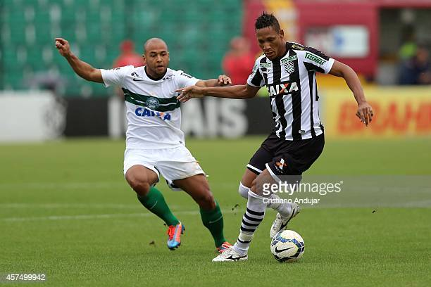 Sergio Manoel of Coritiba try to stops Marcao of Figueirense during a match between Figueirense and Coritiba as part of Campeonato Brasileiro 2014 at...