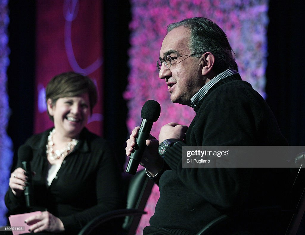 Sergio Marchionne (R), Chairman and CEO , Chrysler Group LLC, and CEO, Fiat S.p.A., responds to a question that was posed to him by Rebecca Lindland, Director of Research for IHS Automotive, after he spoke at the Inforum 11th Annual Auto Show Breakfast at the Detroit Mariott Renaissance Center January 18, 2013 in Detroit, Michigan. The topics of the speech were Marchionne's leadership principles, winning the talent war with diversity and inclusion, and the making of Chrysler's Superbowl ads.