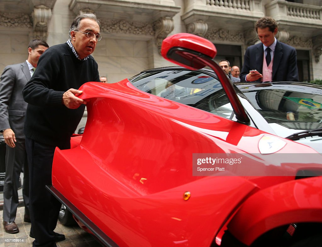 Fiat chrysler heads marchionne and elkann celebrate listing on sergio marchionne chief executive officer fiat chrysler automobiles is viewed next to a ferrari biocorpaavc