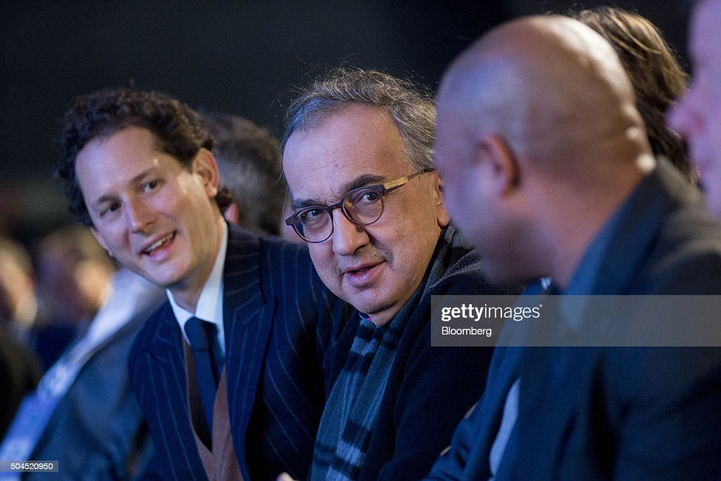 Sergio Marchionne, chief executive officer of Fiat Chrysler Automobiles NV, center, and John Elkann, chairman of Fiat Chrysler Automobiles NV, left, attend the 2016 North American International Auto Show (NAIAS) in Detroit, Michigan, U.S., on Monday, Jan. 11, 2016. Last year's auto show featured 55 vehicle introductions, a majority of which were worldwide debuts, and was attended by over 5,000 journalists from 60 countries. Photographer: Andrew Harrer/Bloomberg via Getty Images