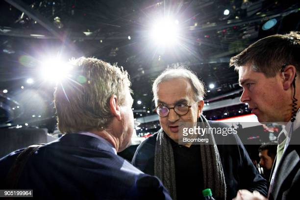 Sergio Marchionne chief executive officer of Fiat Chrysler Automobiles NV speaks to an attendee during the 2018 North American International Auto...