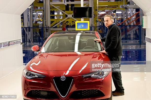 Sergio Marchionne chief executive officer of Fiat Chrysler Automobiles NV with the new Alfa Giulia during the visit to the factory Alfa Romeo in...